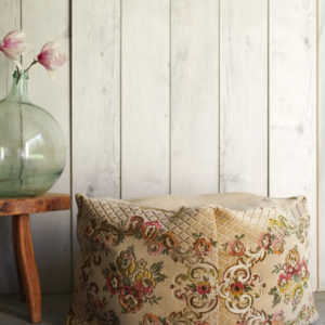 French Upcycled furniture with this ottoman made from old velvet.